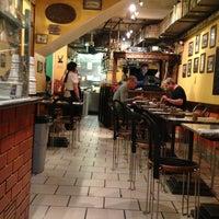 Photo taken at La Porchetta Pollo Bar by Benjamin O. on 6/3/2013