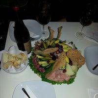 Photo taken at Cafè de Paris by Michael T. on 2/26/2013