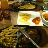 Photo taken at Steak 21 by Riyanto on 1/12/2014