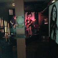 Photo taken at Stompin' Grounds Coffee & Cocktail Lounge by Nick C. on 3/9/2013