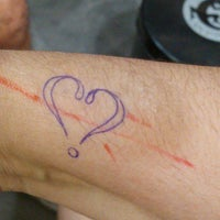 Photo taken at Love Tattoo by Maiby M. on 4/1/2015