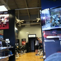 Photo taken at SportClips by ADAM S. on 3/6/2014