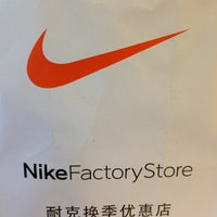 Photo taken at Nike factory store by Larissa B. on 7/14/2013