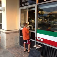 Photo taken at Tomasino's Pizza by Matthew C. on 6/30/2013
