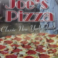 Photo taken at Joe's Pizza by The Aridas Team a. on 9/10/2013