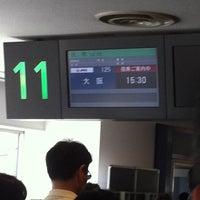 Photo taken at Gate 11 by Kayoko O. on 9/17/2012