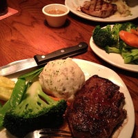 Photo taken at Outback Steakhouse by Ashley on 12/29/2012