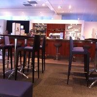 Photo taken at Bar Du Novotel by Marjorie T. on 4/24/2013