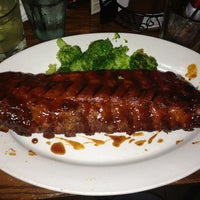 Photo taken at Smokey Bones Bar & Fire Grill by Breanna S. on 2/22/2013
