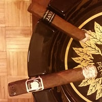 Photo taken at Cigar Exchange by Kelly A. on 8/21/2015