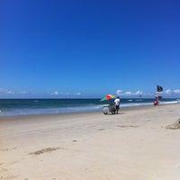 Photo taken at Guacyara Beach by Mônica M. on 1/18/2014