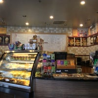 Photo taken at Organic Coffee Co. by Lee O. on 10/14/2012
