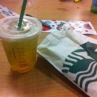 Photo taken at Starbucks by bibz on 12/8/2012
