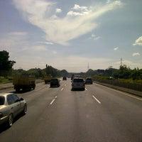 Photo taken at Jalan Tol Jakarta - Cikampek by Alponso P. on 12/30/2012