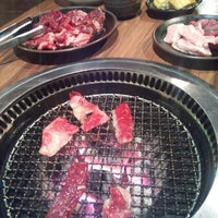Photo taken at 炭火焼肉 いがいガ by Maki S. on 7/19/2013