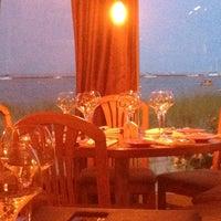 Photo taken at Mews Restaurant & Cafe by Tara R. on 6/23/2013
