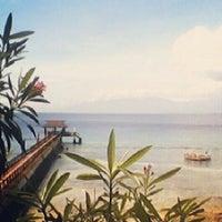 Photo taken at Golden Bay Beach Resort by Kassandra M. on 12/30/2012