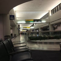 Photo taken at Gate C86 by Michael Y. on 12/30/2012