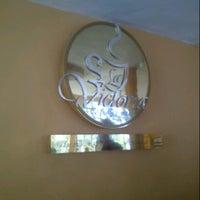 Photo taken at La Victoria café gourmet by Jesus C. on 7/19/2014