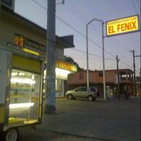 Photo taken at El Fénix by Jesus C. on 7/14/2013