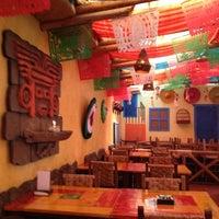 Photo taken at Totopos Gastronomia Mexicana by Elisa C. on 10/19/2012