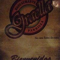 Photo taken at Graella Restaurante Parrilla by Javier J. on 8/1/2013