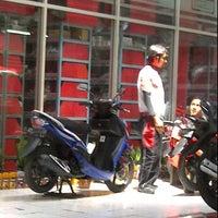 Photo taken at Agung Motor Yamaha by Lusia W. on 11/24/2012