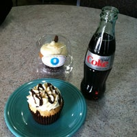 Photo taken at Oh My Cupcakes! by Brienne M. on 3/22/2013