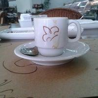 Photo taken at Palato Café by Rafaela P. on 2/12/2013