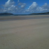 Photo taken at Tramore Beach by Gerry M. on 8/7/2013