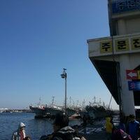 Photo taken at 주문진수산시장 by JuneWan K. on 3/2/2013