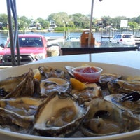 Photo taken at Rick's on the River by david m. on 10/21/2012