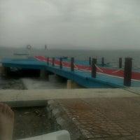 Photo taken at Alkoru Beach by Dilara İ. on 6/19/2014