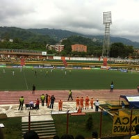 Photo taken at Estadio Alfonso López by Hector C. on 5/19/2013