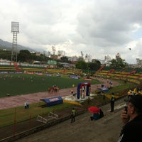 Photo taken at Estadio Alfonso López by Hector C. on 5/12/2013