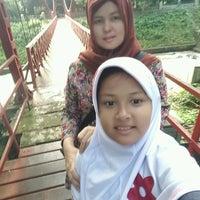 Photo taken at Jembatan Merah Kebun Raya Bogor by novi E. on 10/1/2016