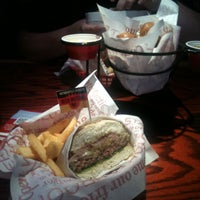 Photo taken at Red Robin Gourmet Burgers by Jason E. on 9/24/2012