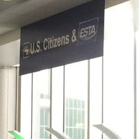 Photo taken at US Customs & Immigration by Jessica C. on 10/24/2014