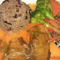 Photo taken at VIVID Caribbean American Bistro by Christina C. on 2/24/2013