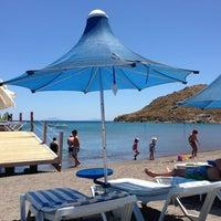 Photo taken at Parıltı Beach by Nil E. on 7/1/2013