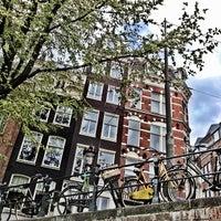 Photo taken at Amsterdam by Lorena P. on 5/11/2013