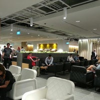 Photo taken at The Qantas Singapore Lounge by Elliot H. on 6/21/2013
