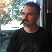 Photo taken at Outman Cigars & Martini Bar by jon E. on 7/30/2012