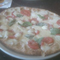 Photo taken at Brixx Wood Fired Pizza by Sara B. on 5/24/2012