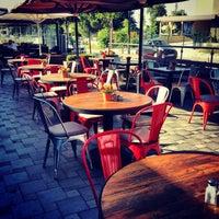 Photo taken at The Winston Brasserie by Gürhan Ş. on 6/21/2013