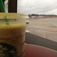 Photo taken at Concourse C by Cliff B. on 12/26/2012