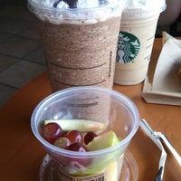Photo taken at Starbucks by Emily W. on 5/12/2013