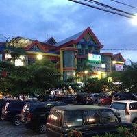 Photo taken at Mataram Mall by Rebecca on 12/13/2013