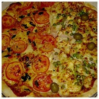 Photo taken at Pizzaria Brasil by Andréa A. on 6/18/2014