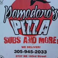 Photo taken at Pomodoro's Pizza by Lady L. on 12/17/2013